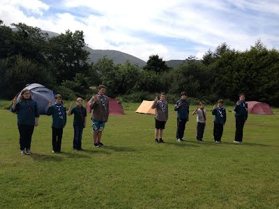 Scouts at summer camp Flag Break saying Scout Promise